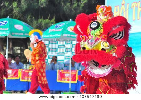 Nha Trang, Vietnam - July 14, 2015: Young Boys Are Performing The Lion Dance On The Beach Of Nha Tra