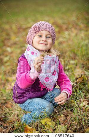 Portrait little girl in autumn park