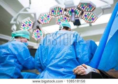 Unidentified boy undergoing a surgery. Focus on the monitor with vital functions