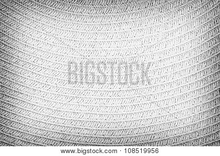 Woven straw background or texture. Gray color.