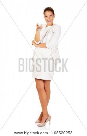 Young businesswoman holding house keys.