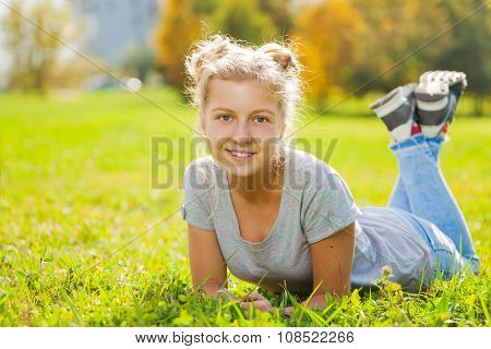 Girl close-up view laying on green grass