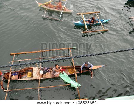 People in Outrigger Canoes