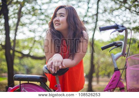 Happy Fatty Woman Posing With Bicycle