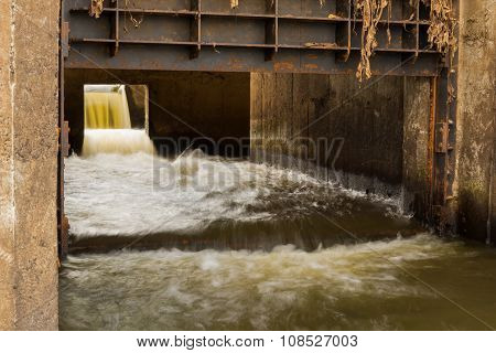 Waste Water flowing from city drain pipe