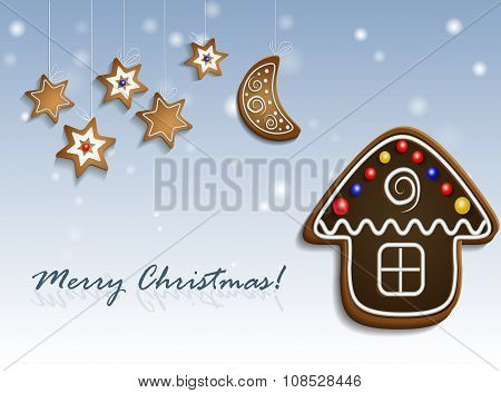 Gingerbread stars and house on snow background