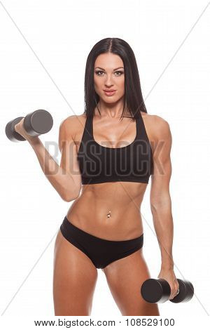 Beautiful slim woman with dumbbells, isolated on white background