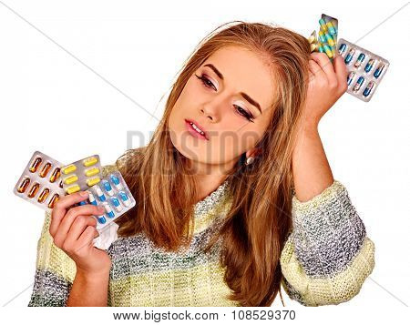 Portrait of girl with headache holding tablet .  Isolated.