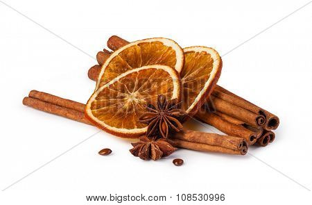 dried oranges and cinnamon isolated on white background