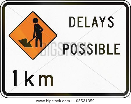 New Zealand Road Sign - Road Workers Ahead In 1 Kilometre, Delays Possible