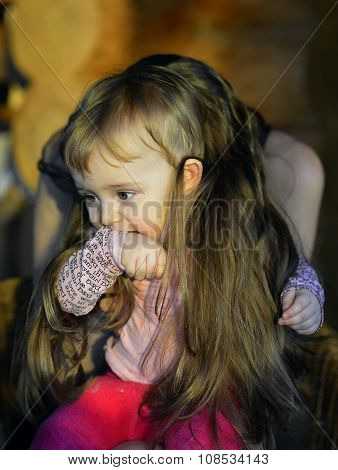 The Ruffled Hairdress. Portrait Of The Laughing Little Girl In A Chair