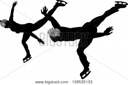 Silhouettes Of Couple Of Skaters On The Ice