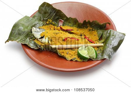 ikan pepes, indonesian cuisine, steamed fish wrapped in banana leaves isolated on white background