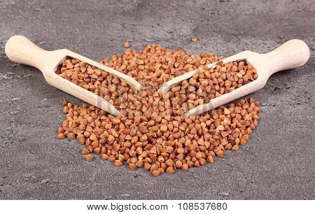 Buckwheat Groats With Spoon On Cement Structure