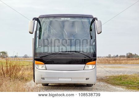 travel, tourism, road trip and passenger transport - tour bus staying outdoors