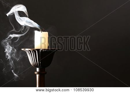 Extinguished Candle On Dark