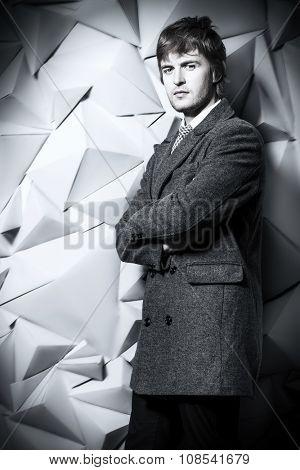 Portrait of a man in an elegant coat. Beauty, fashion. Studio shot.