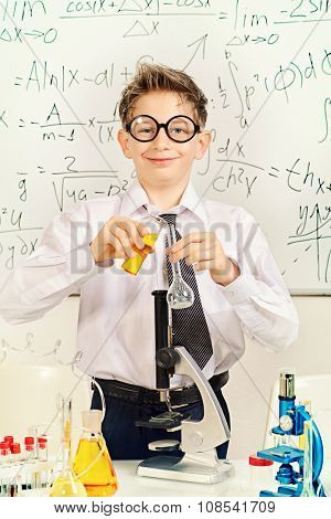A boy is working in the laboratory. Science and education concept. School.
