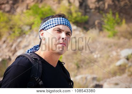 A Man In A T-shirt And A Bandanna On Nature