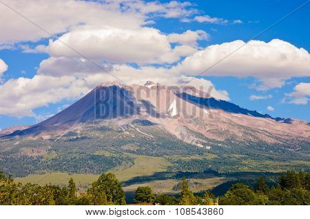 Mount Shasta, California a sacred mountain for the indigenous peoples with clouds around it