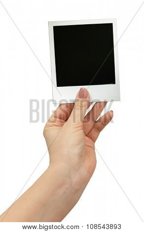 Polaroid photo in hand isolated on white background