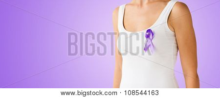 charity, people, health care and social issue concept - close up of woman with purple domestic violence awareness ribbon on her chest over violet background