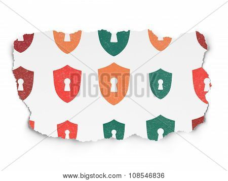Protection concept: Shield With Keyhole icons on Torn Paper background