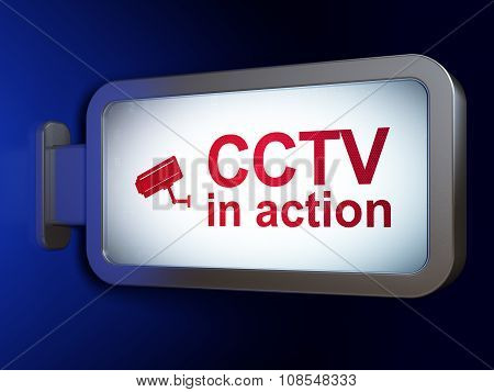 Protection concept: CCTV In action and Cctv Camera on billboard background