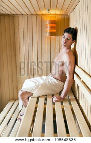 Handsome Man Relaxing In A Sauna