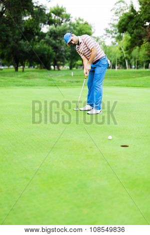 Golfer Takes The Putting Green Shot