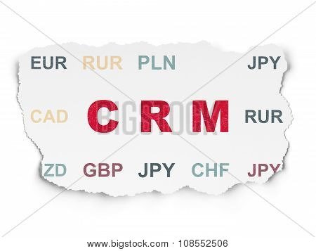 Business concept: CRM on Torn Paper background