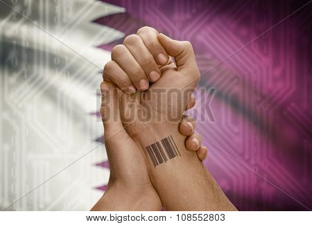 Barcode Id Number On Wrist Of Dark Skinned Person And National Flag On Background - Qatar