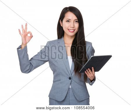 Asian Young Businesswoman hold with tablet and ok sign gesture