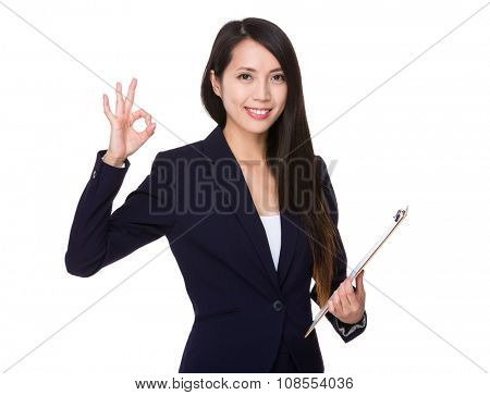 Businesswoman hold with clipboard and ok sign gesture