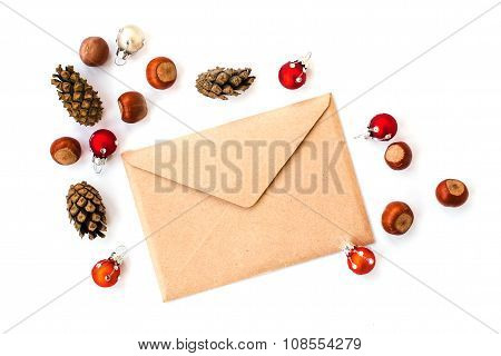 Envelope, cones, hazelnuts and christmas decorations