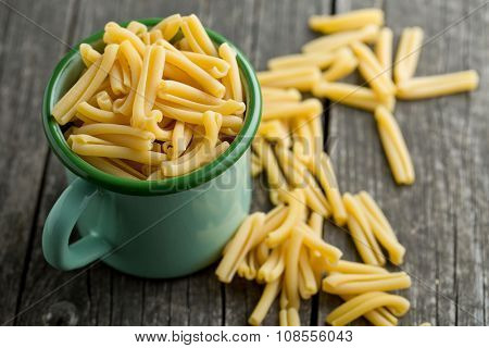uncooked pasta caserecce in cup