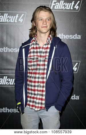 LOS ANGELES - NOV 05:  Lucas Till at the Fallout 4 video game launch  at the downtown on November 05, 2015 in Los Angeles, CA