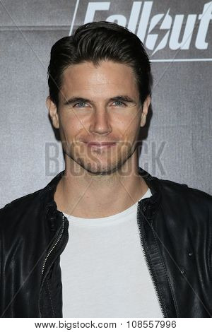 LOS ANGELES - NOV 05:  Robbie Amell at the Fallout 4 video game launch  at the downtown on November 05, 2015 in Los Angeles, CA