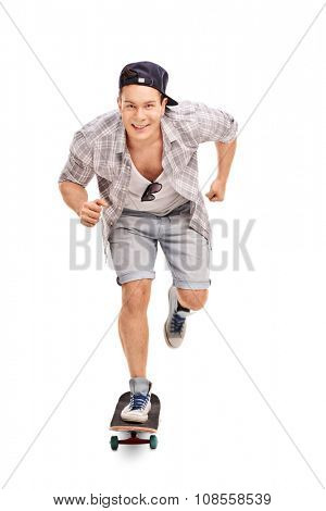 Full length portrait of a young skater riding a skateboard and looking at the camera isolated on white background