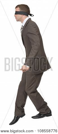 Businessman walking gingerly with band on his eyes