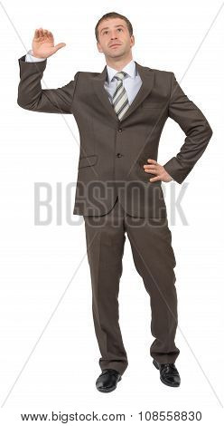Businessman leans on empty space