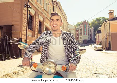 Young Handsome Man Riding A Motorbike