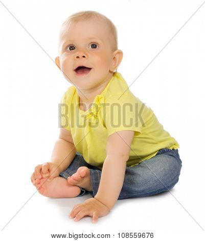 Little baby in blue jeans isolated