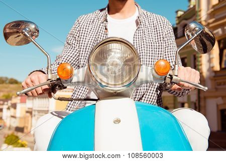 Closeup Photo Of A Handsome Man Riding A Scooter