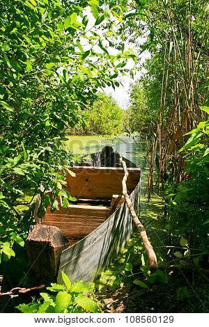 Old Wooden Boat At The River Bank.