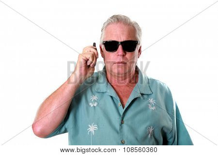 A handsome man uses a walkie talkie to communicate with someone. isolated on white with room for your text