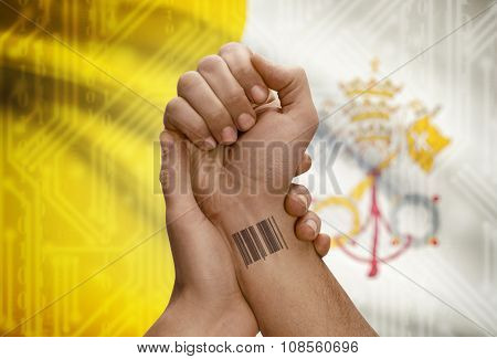 Barcode Id Number On Wrist Of Dark Skinned Person And National Flag On Background - Vatican City Sta