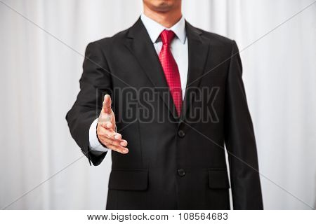 businessman handing out his hand