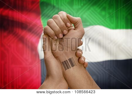 Barcode Id Number On Wrist Of Dark Skinned Person And National Flag On Background - United Arab Emir