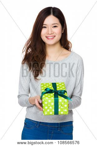 Asian Young Woman hold with present box